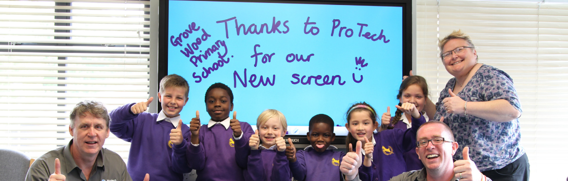 Protech Solutions celebrating with a school class after installing a new interactive screen