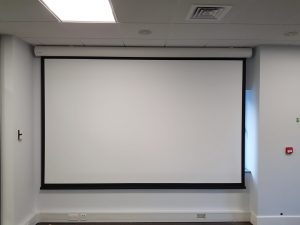 Image of a board room projector and pulldown electric screen